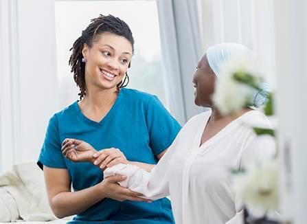 Nurse taking care of patient at home - Nurse taking care of patient at home