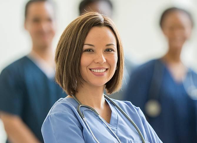 smiling woman in a nurse's uniform