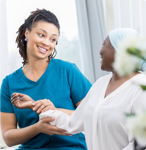 Smiling nurse and a patient - Advantage Medical Professionals