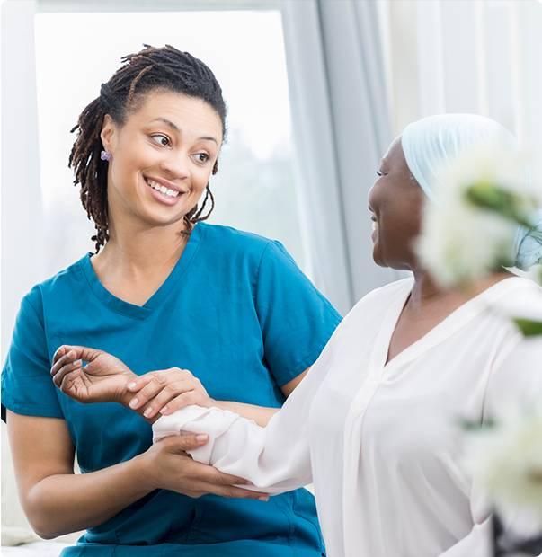 Nurse Smiling to the patient - Advantage Medical Professionals
