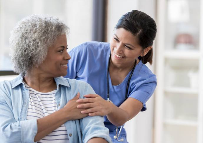 a nurse with an old patient - Advantage Medical Professionals
