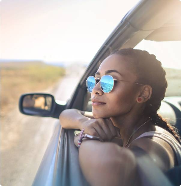 a girl travelling with car