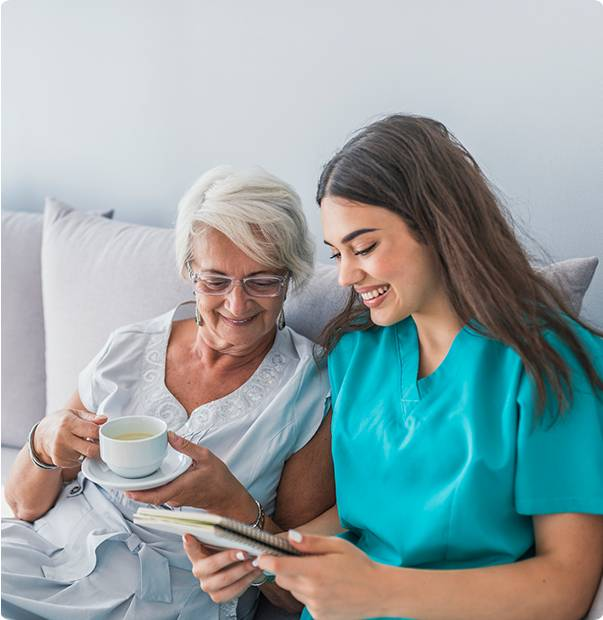 Nurse taking care of elderly patient in bed - Advantage Medical Professionals